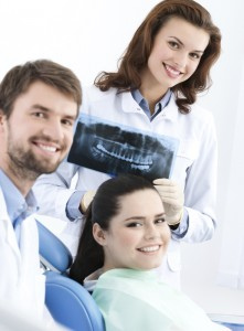 Dentist, assistant and client are satisfied of their work, close up