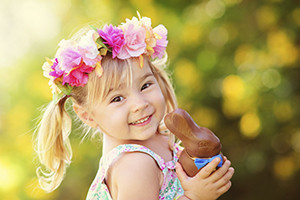 cute easter girl with chocolate bunny outdoor